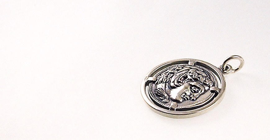 Alexander the Great Coin Pendant depicting head of Hercules. Sterling silver on bezel