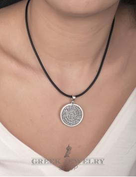 A Greek silver Festos disk pendant